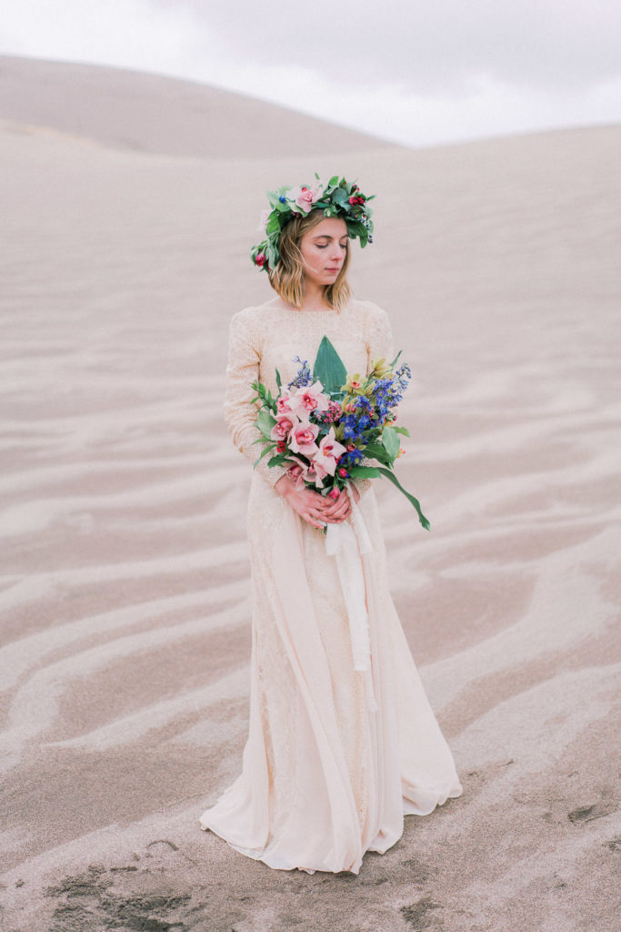 elopement in the Great Sand Dunes in Colorado with tropical florals