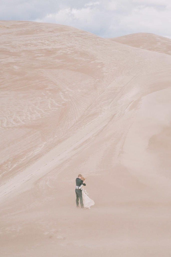 windy elopement on the dunes of Colorado