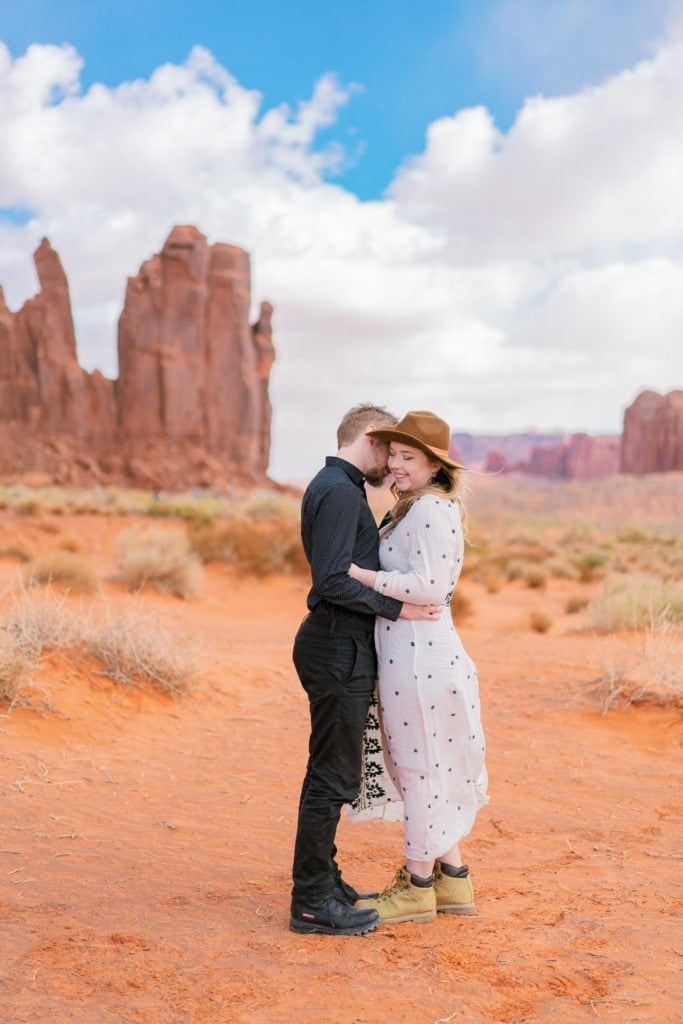 colorful photography of a couple on an adventure session in Monument Valley