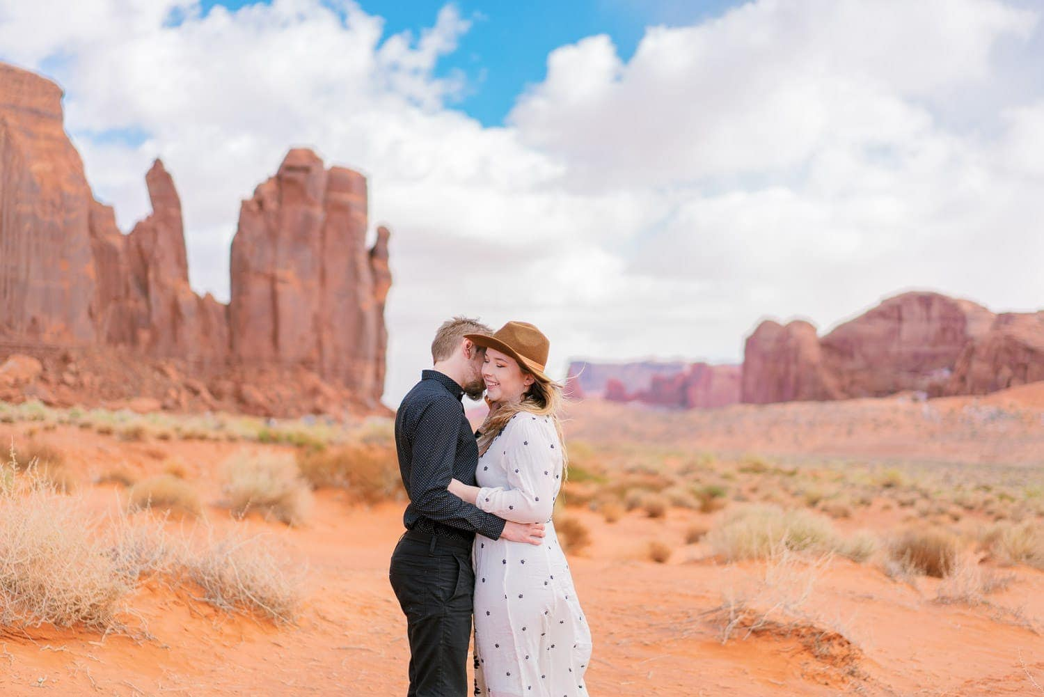couple laughing on an engagement session in Moab, Utah