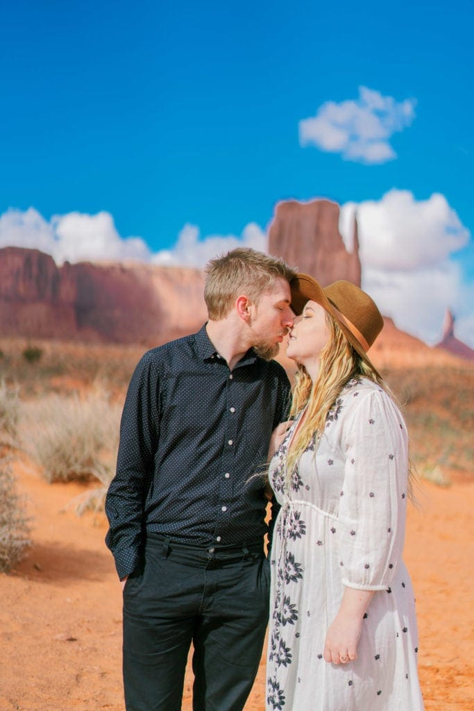 couple kissing in Monument Valley during their engagement session