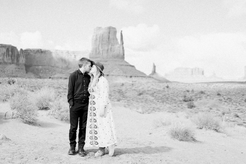 black & white film photography of a couple on their elopement in Monument Valley