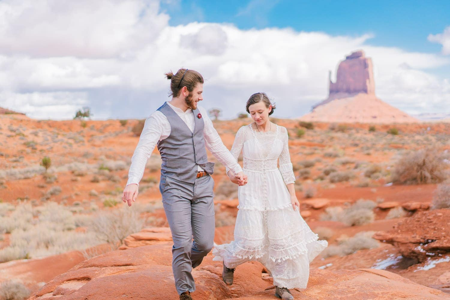 couple hikes on their wedding day in Monument Valley
