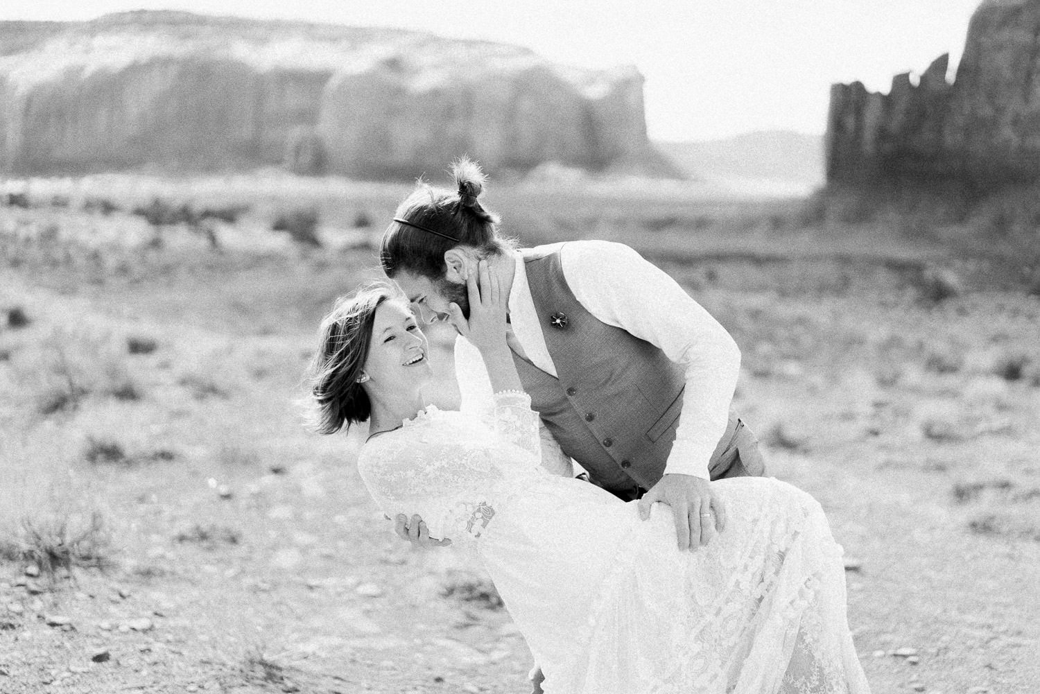 fun loving couple elopes in Monument Valley Utah