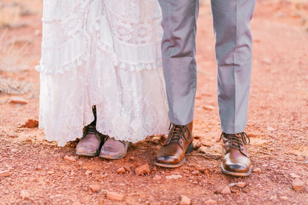 hiking boots on an elopement while hiking in Monument Valley