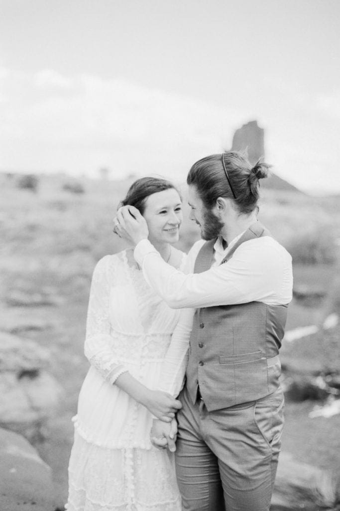 black and white film photo of a couple in Monument valley on their hiking elopement