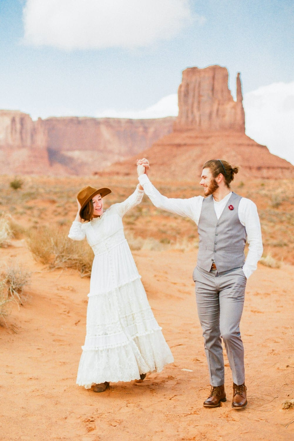 couple celebrates after an elopement in Monument Valley