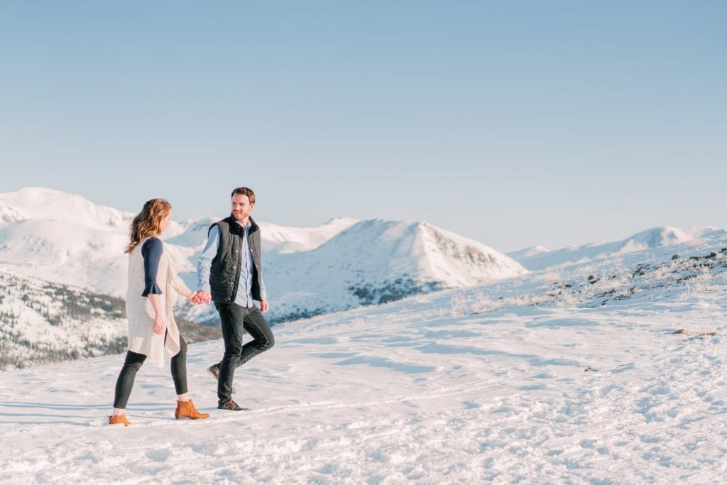 Nate & Kelsey | walking along a snowy trail during an engagement session in Colorado
