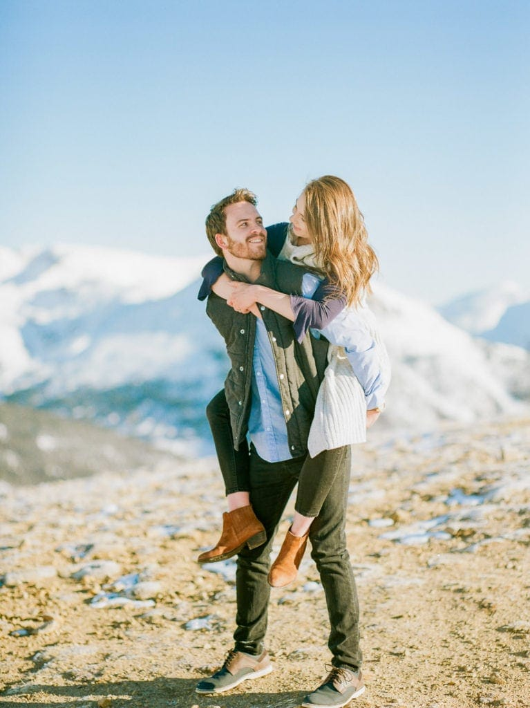Nate & Kelsey | posing on top of a mountain during a Colorado engagement session at Loveland Pass
