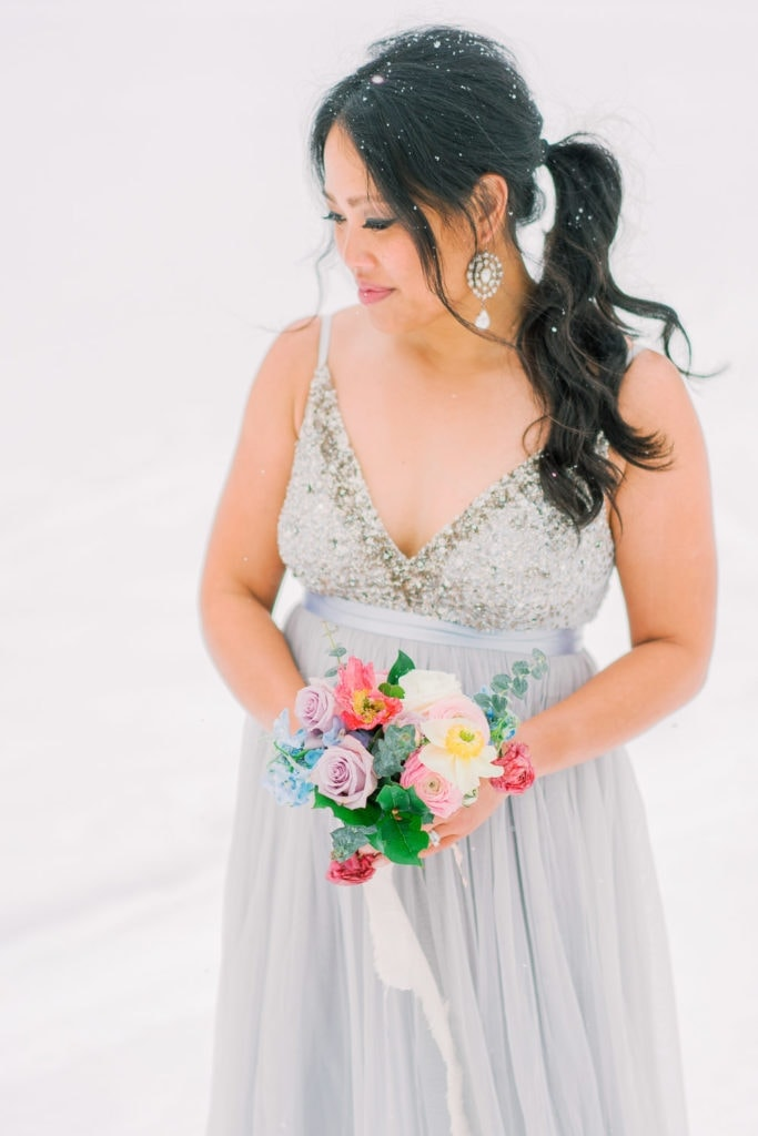bridal photography with an elopement floral bouquet in winter