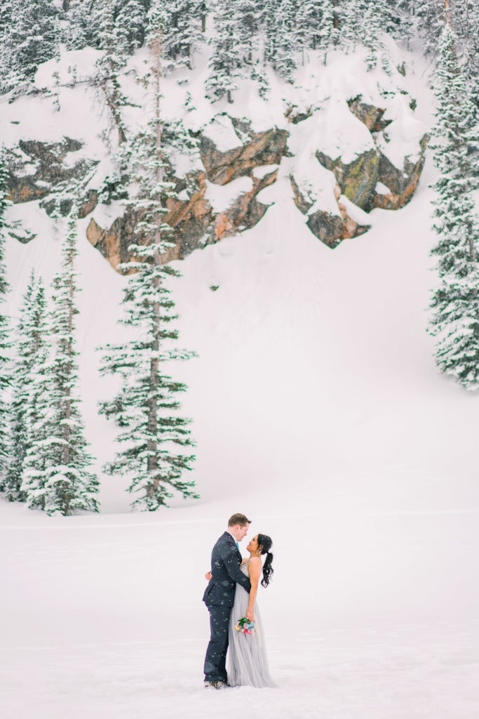 hiking elopement in Rocky Mountain National Park at a frozen lake in winter | Colorado elopement photographer