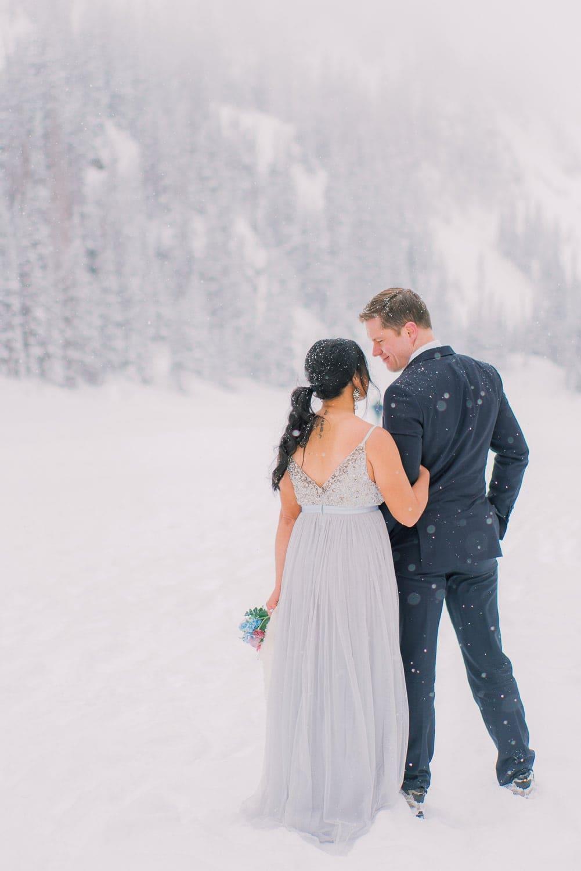 winter elopement on a frozen lake