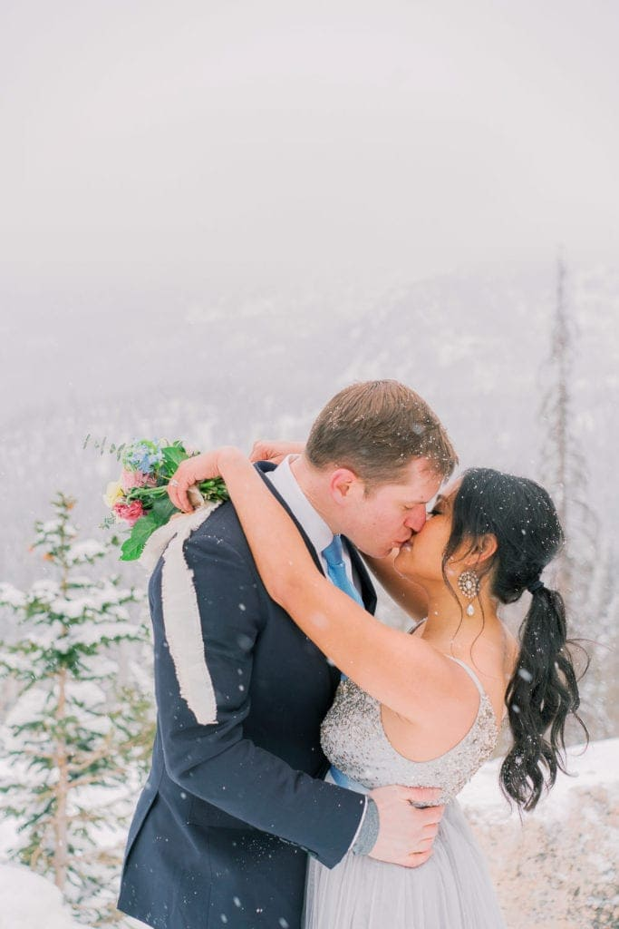 kissing during a vow renewal in Rocky Mountain National Park in Colorado