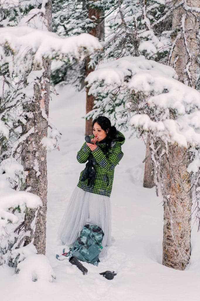 getting ready outside for a winter elopement in Colorado