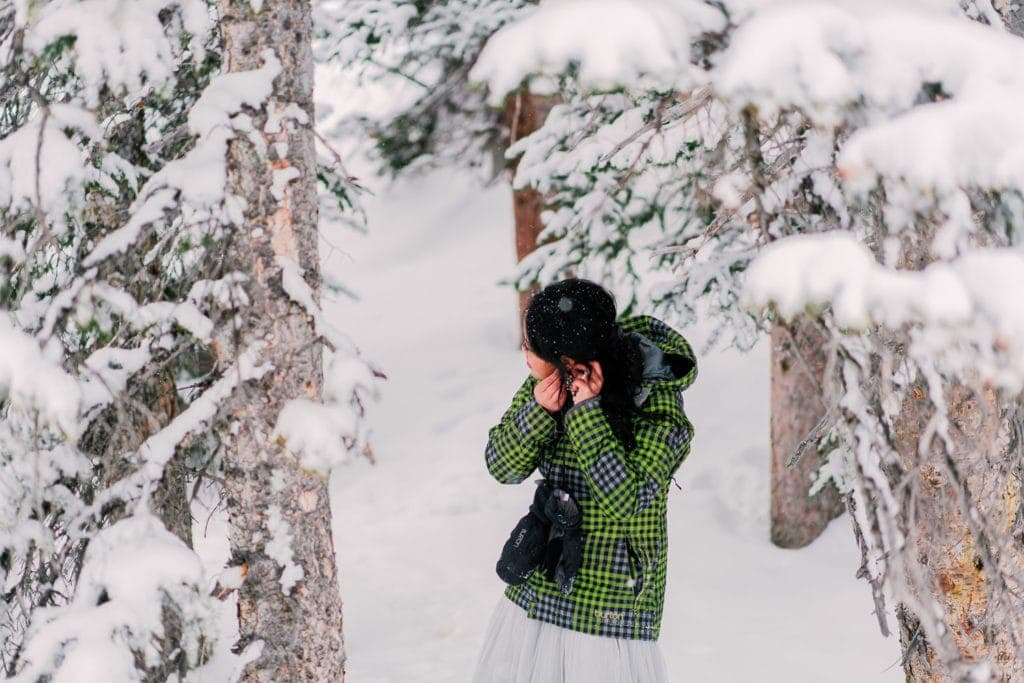 bride getting ready outside for a winter elopement in Colorado