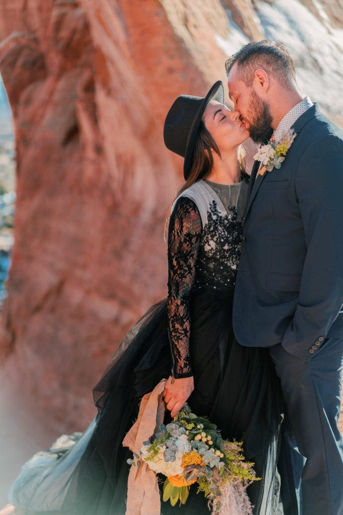 elopement in Moab, Utah with a desert inspired bouquet and a black dress
