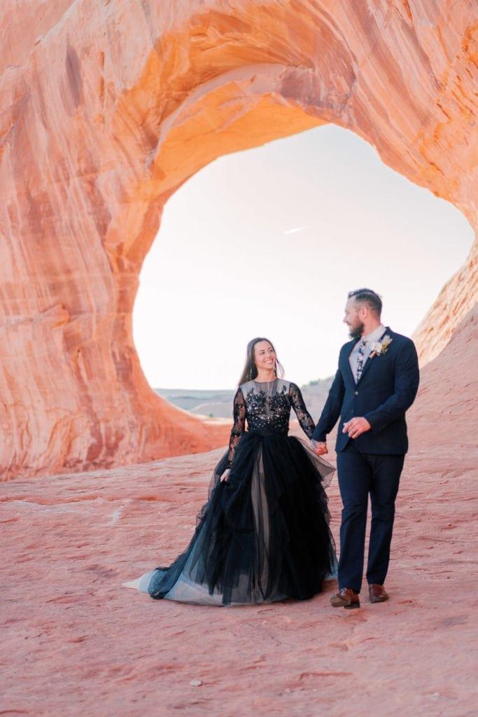 Moab elopement under an arch