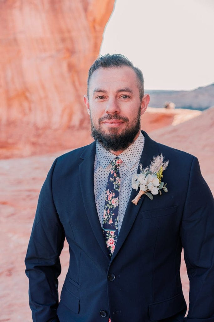 groom at an elopement in Moab, UT