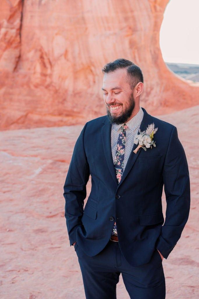 portrait of a groom at a desert elopement in Moab, UT