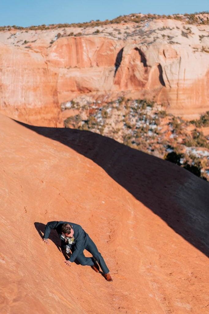 climbing and hiking at an elopement in Moab, UT
