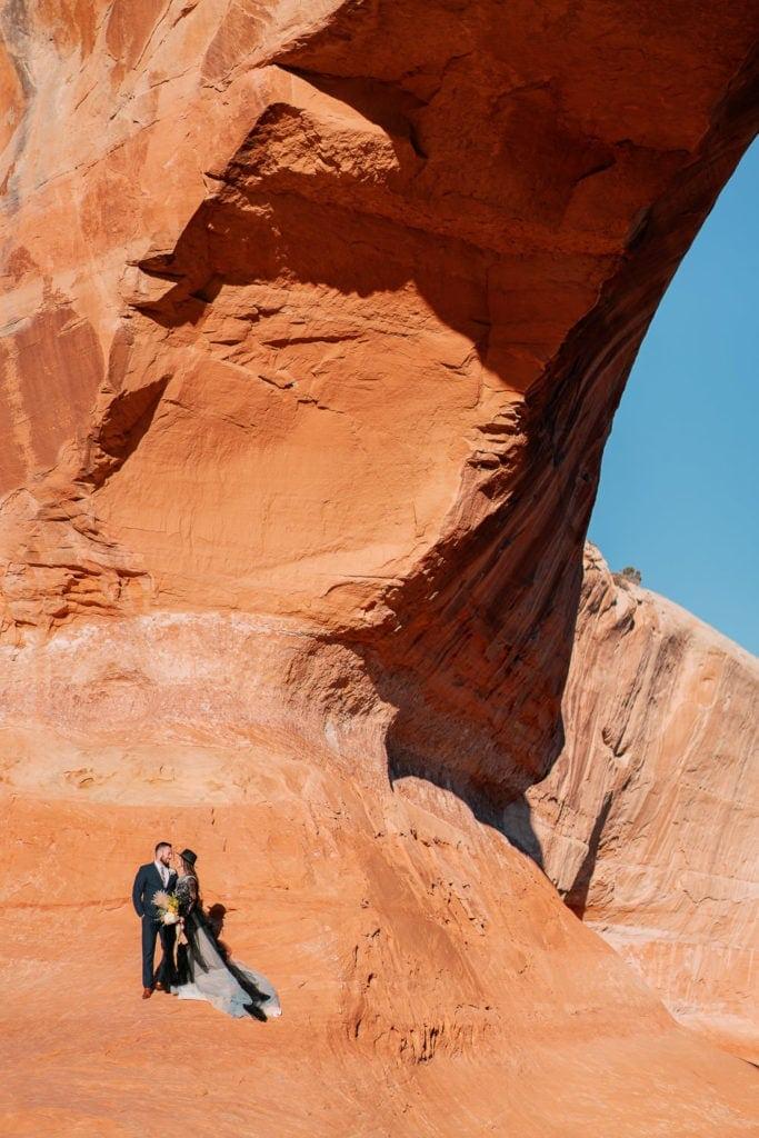 adventure wedding under an arch in Moab, Utah