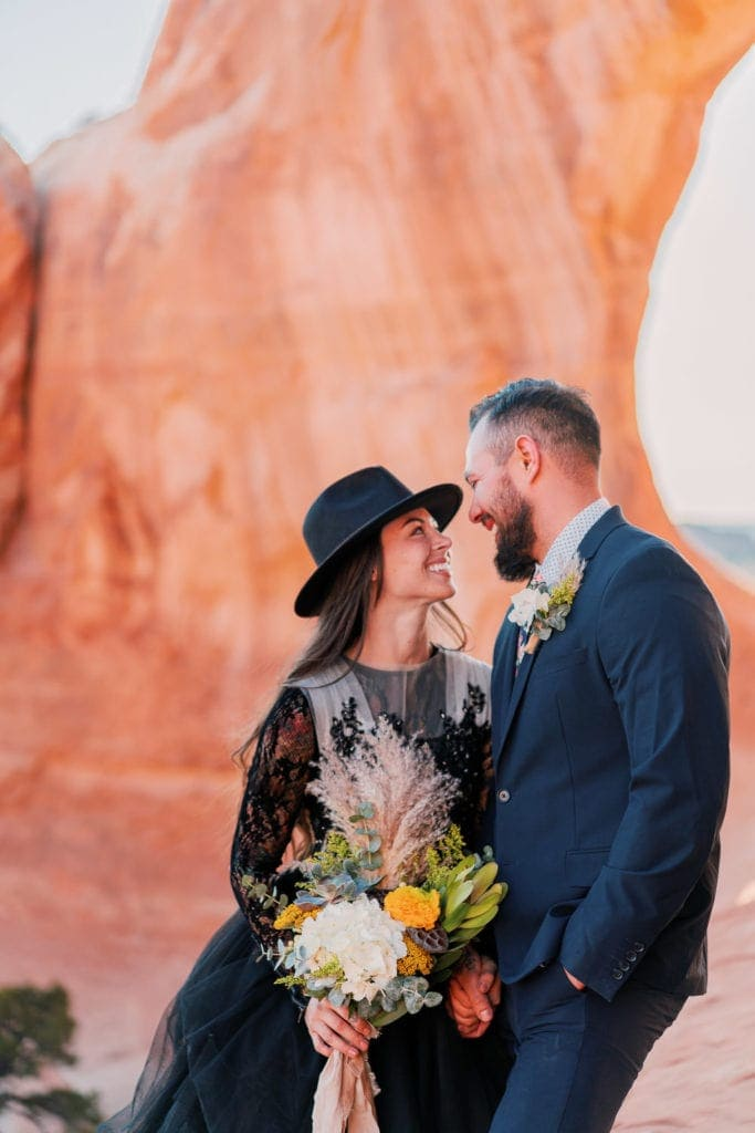 elopement photographer in Moab, UT | elopement in Moab with a black dress in the desert