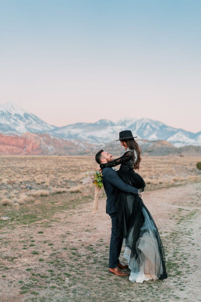 fun and romantic elopement photography in Moab, Utah at sunset in spring