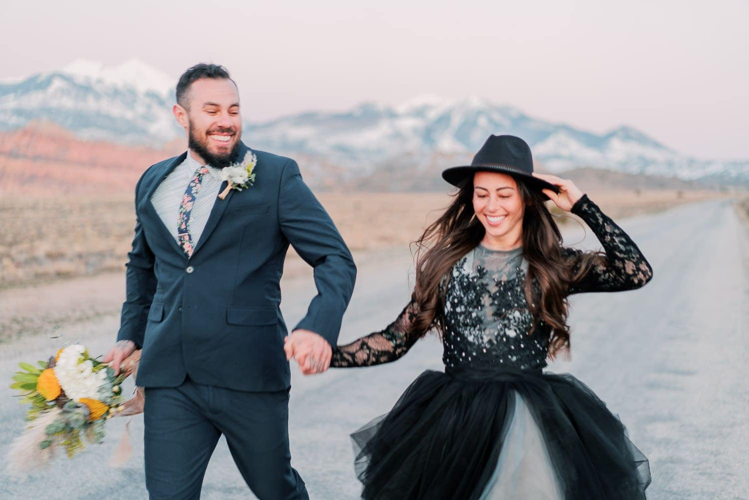 Moab, Utah elopement in a black dress with arches and mountain views