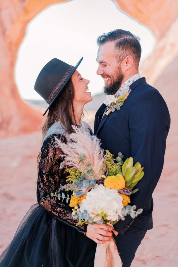 elopement under an arch in moab