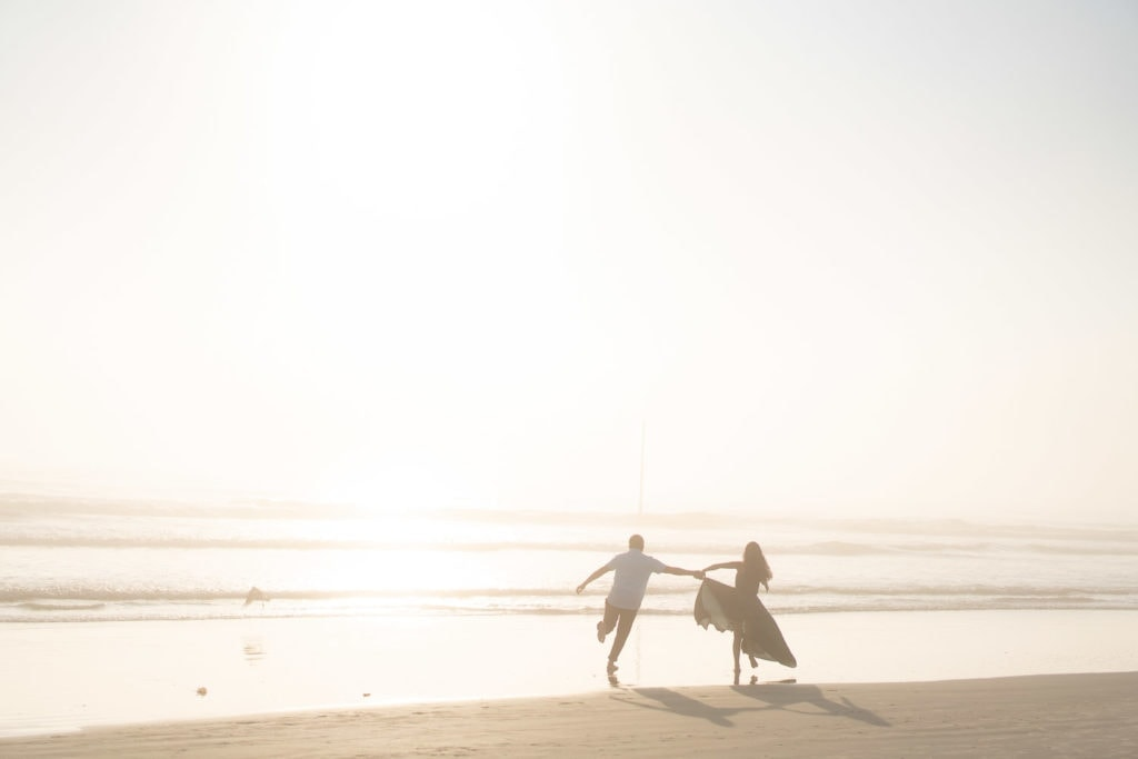 fun and wild elopement on the beach at sunrise in Florida