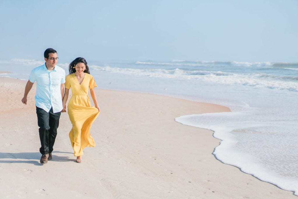 bride and groom running along the beach during an elopement in Florida