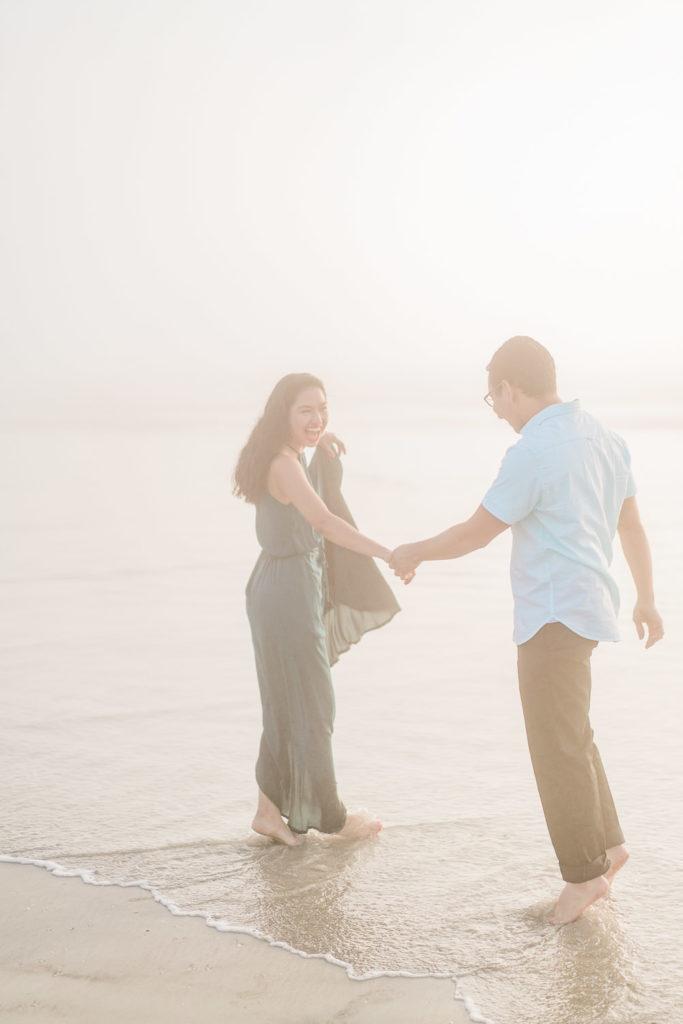 fun engagement photography at sunrise on Daytona Beach
