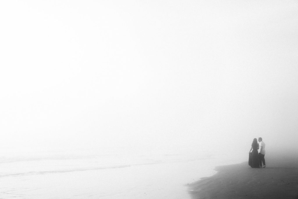 moody black and white photography at a foggy elopement on the beach in Florida