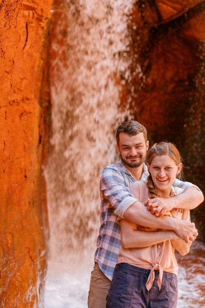 engagement photography in Moab, Utah at a waterfall