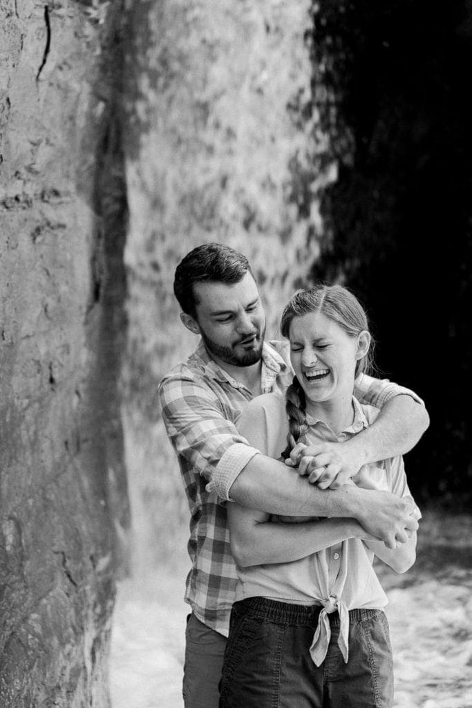black and white photography at an engagement session at a waterfall