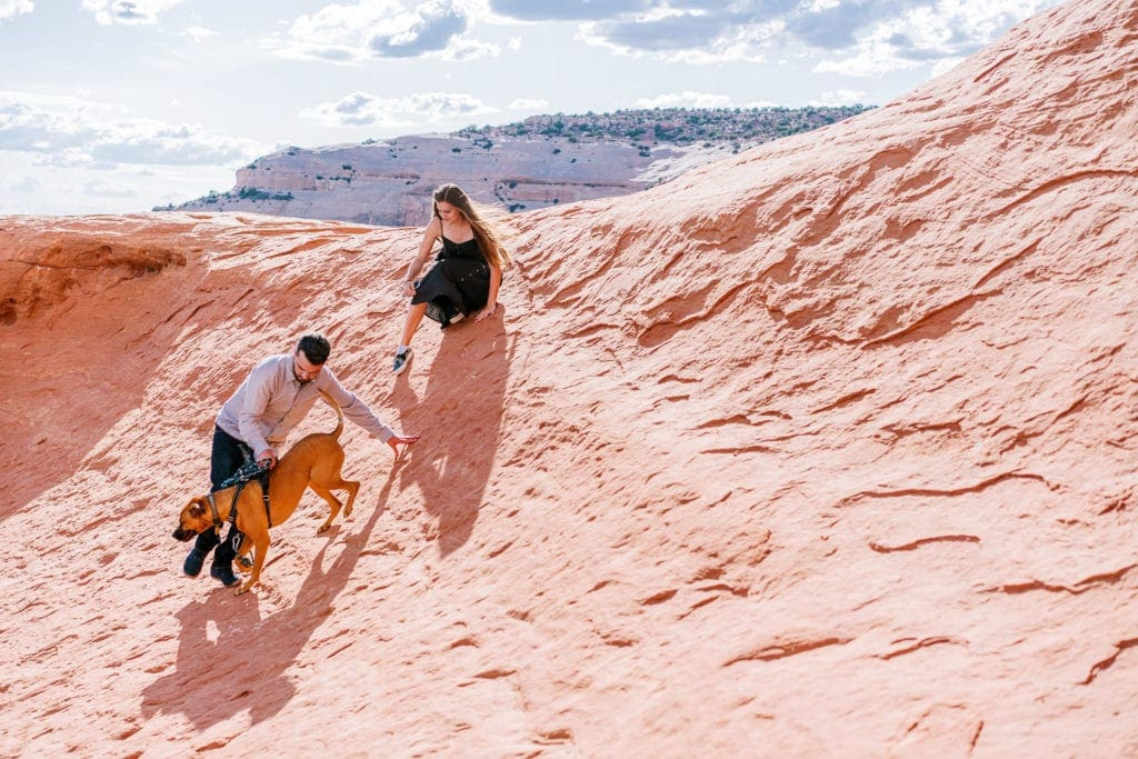 adventuring during an engagement session in Arches National Park