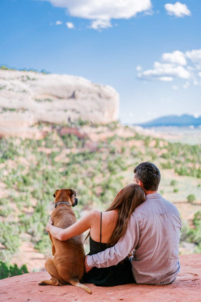 Moab engagement session with a couple and their dog