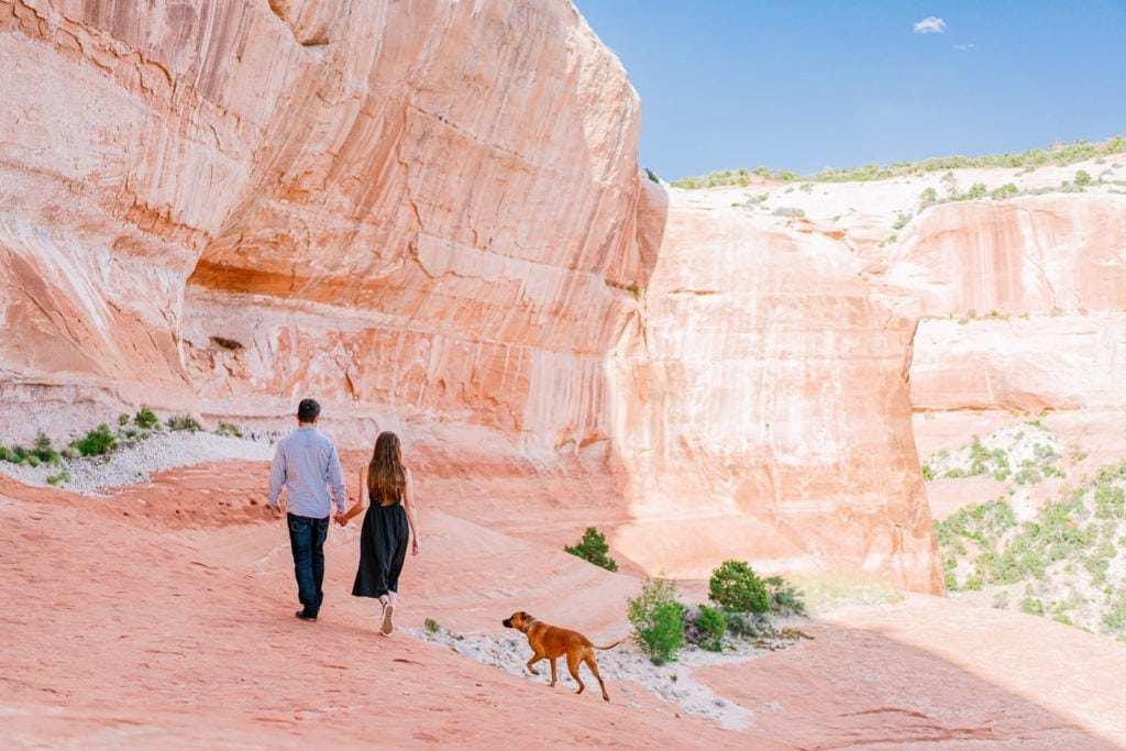 couple gets engaged in Moab | engagement photography with a dog