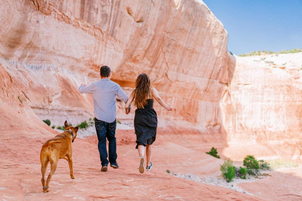 fun engagement photos in Moab with a couple and their dog