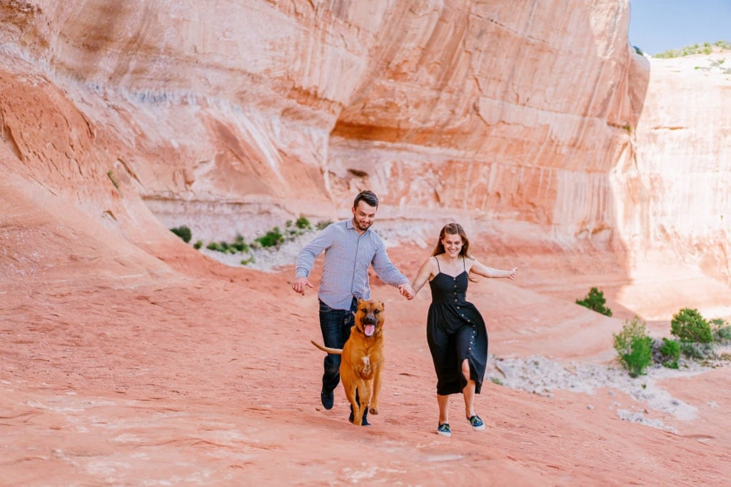 fun engagement photography in Moab, UT with a couple and their dog | Moab photographer in Arches National Park