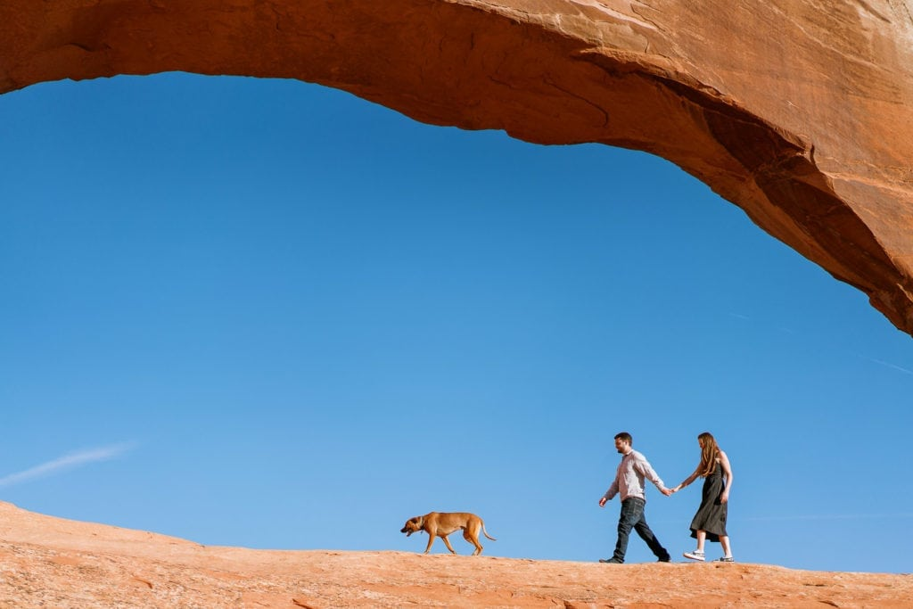 adventure session in Moab, UT with a couple and their dog