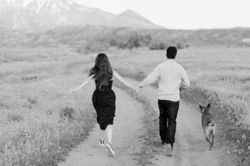 fun black and white photography during an engagement session in Moab