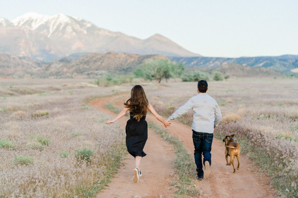 fun and colorful engagement photography in Moab with the Manti-La Sal Mountains