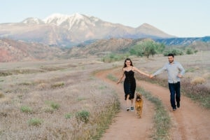 fun engagement session in Moab with a dog in the mountains