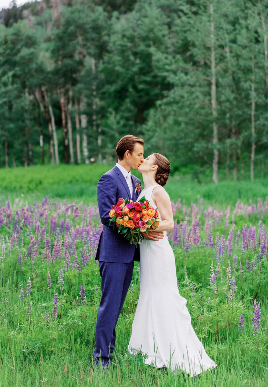 Colorado elopement in wildflowers in the mountains