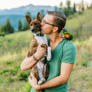 Malachi Lewis at Shell Creek Photography with his dog and parrot