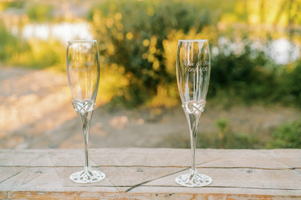 Custom engraved champagne flutes at an elopement.