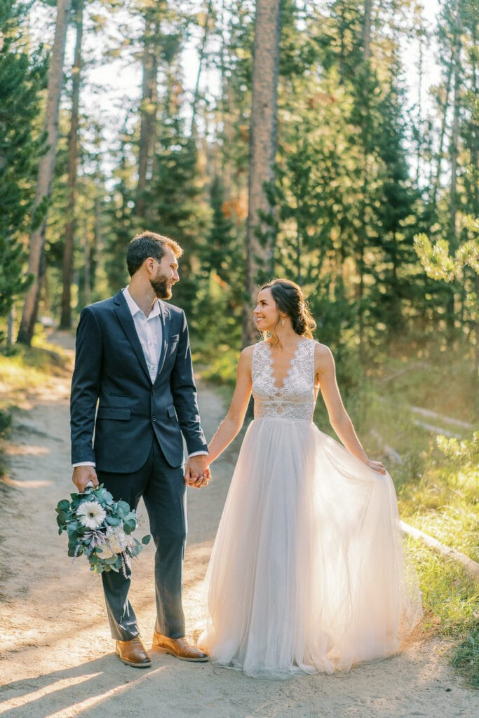 Bride and groom hiking in Grand Teton National Park.