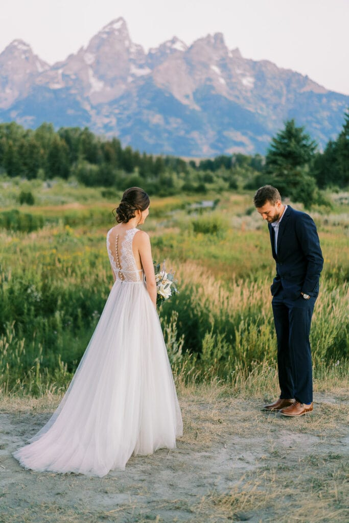 First look for a bride and groom at their elopement in Wyoming.
