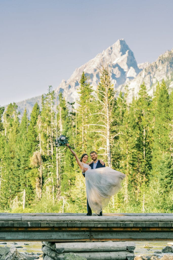 Bride and groom celebrate their Grand Teton National Park elopement.